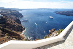 Traveling and wanderlust. Nature and environment. Tourist ship and water transport. Panoramic view of old port and mediterranean sea in Santorini island Royalty Free Stock Photos