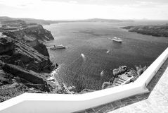 Traveling and wanderlust. Nature and environment. Tourist ship and water transport. Panoramic view of old port and mediterranean sea in Santorini island Royalty Free Stock Images