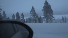 Traveling on winter road in the highway. Car on winter road in the morning stock video footage