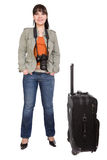 Traveling woman. Attractive brunette woman with suitcase. over white background Royalty Free Stock Photo