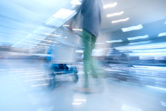 Traveling woman in airport terminal. Abstract motion blur Royalty Free Stock Image