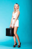 Traveling woman with luggage, sexy girl holding travel bag Royalty Free Stock Photography