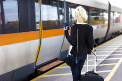 Traveling woman at a outdoor train station terminal Royalty Free Stock Images