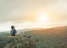 Traveling woman relaxing trekking on rock cliff use for people l Stock Image