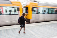 Traveling woman at the station Stock Photography