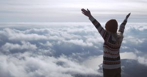 Traveling Woman success raised hands enjoying landscape over clouds on mountains summit Lifestyle concept. Adventure vacations outdoor happy emotions stock footage