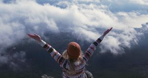 Traveling Woman success raised hands enjoying landscape over clouds. On mountains summit Lifestyle concept adventure vacations outdoor happy emotions stock video footage