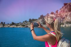Traveling woman take a photo mountain view, travel concept.  royalty free stock images