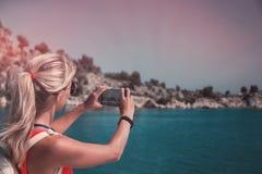Traveling woman take a photo mountain view, travel concept.  royalty free stock photos
