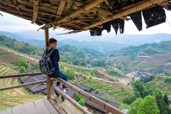 Traveling young woman with backpack on the background of rice te Stock Images
