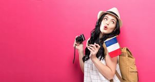 Traveling young woman holding a camera with Italian flag. On a solid background Royalty Free Stock Photo