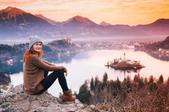 Traveling young woman looking on sunset on Bled Lake, Slovenia, royalty free stock photography