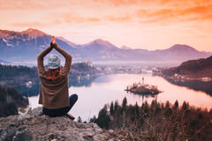 Traveling young woman looking on sunset on Bled Lake, Slovenia, Stock Photo