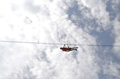 Traveling a zip-line horizontally Stock Photography