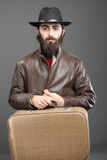 Traveller. With suit-case, dressed in jacket and hat stock photo