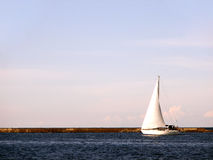 Traveller. White yacht sail on blue sky background. Very romantic Stock Photo