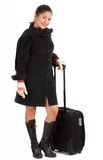 Traveller. A young beautiful traveller holding her luggage Stock Image
