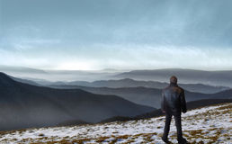 Traveller. Lonely man stands in front of wilderness landscape Stock Images