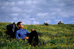 Traveller. Resting in a field of yellow flowers Royalty Free Stock Images
