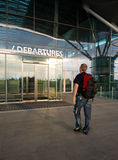 Traveller in airport. In front of Departures terminal Royalty Free Stock Images