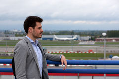Traveller airport plane. Traveler at the airport with a runway and planes in the blurry background Stock Image