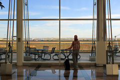 Traveller at airport terminal Royalty Free Stock Photos