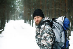Traveller with backpack in winter forest Royalty Free Stock Photo