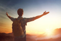 Traveller with backpack. Young man is looking at sunset. Traveller with backpack stock photography