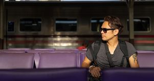 A traveller, backpacker man in casual clothes and sunglasses wit stock images
