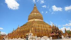 Traveller and Burmese people come to Shwezigon Pagoda at Bagan in Mandalay, Myanmar stock video