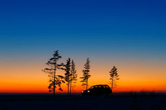 Traveller car against  bright sunset. Royalty Free Stock Photo