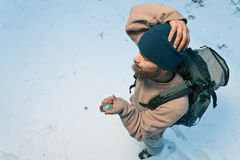 Traveller with compass in winter forest Royalty Free Stock Image