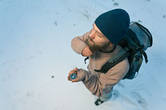 Traveller with compass in winter forest Royalty Free Stock Images