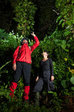 Traveller couple search and explore through tropical rain forest Stock Photo