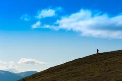 Traveller descending to ocean landscape backdrop Royalty Free Stock Photography