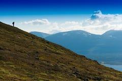 Traveller descending to ocean landscape backdrop Royalty Free Stock Image