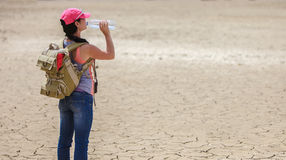 Traveller drinking water from bottle in the desert Royalty Free Stock Photos