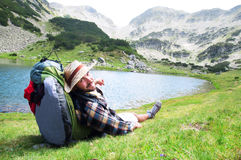 Traveller enjoying the view and relaxing at mountain site. Stock Image