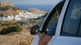Traveller enjoys the panoramic view. From his car stock video footage