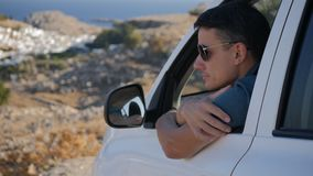 Traveller enjoys the panoramic view. From his car stock footage