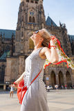 Traveller female on the background of the St. Vitus Cathedral, Prague, Czech Republic Stock Photography