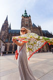 Traveller female on the background of the St. Vitus Cathedral, Prague, Czech Republic Stock Image