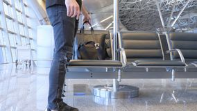 Traveller Leaves Bag on Waiting Chair at Airport. 4k , high quality Stock Image