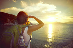 A traveller looking at sunset on the islands Royalty Free Stock Images