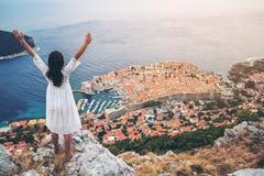 Traveller looking at view of Dubrovnik, Croatia. Traveller looking at view of Dubrovnik city, in Dalmatia, Croatia, the prominent travel destination of Croatia stock photo