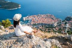 Traveller looking at view of Dubrovnik, Croatia. Traveller looking at view of Dubrovnik Old Town, in Dalmatia, Croatia, the prominent travel destination of stock images