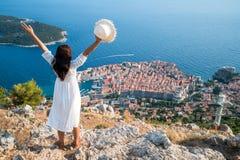Traveller looking at view of Dubrovnik, Croatia. Traveller looking at view of Dubrovnik Old Town, in Dalmatia, Croatia, the prominent travel destination of stock photo
