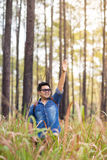 Traveller. A male traveller with backpack in the pine forest, Thailand Stock Photography