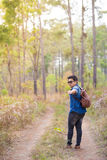 Traveller. A male traveller with his sunglasses and backpack in the pine forest, Thailand Stock Image
