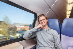 Traveller. Male traveller in a train Royalty Free Stock Photography